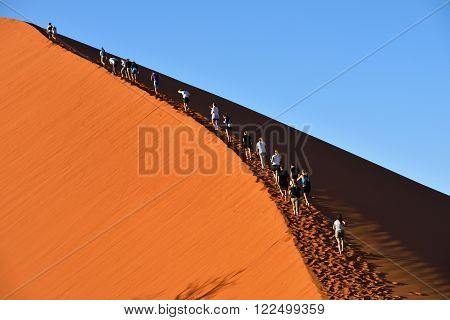 SOSSUSVLEI NAMIBIA - JAN 29 2016: Tourists climb Dune No.45 most popular dune in the whole World Namibia Africa