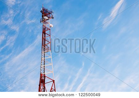 telecommunication tower against a beautiful sky. Cellular antenna on the tower. the beauty of nature and high technology. copy space for your text