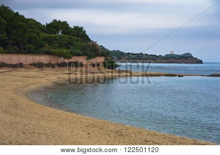 Beach at Nora archeological site, near city of Pula, island of Sardinia, Italy