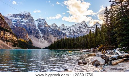 Moraine Lake and the surrounding snow capped mountains in Banff National Park in the Canadian Rockies under blue sky