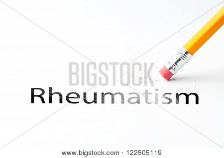 Closeup of pencil eraser and black rheumatism text. Rheumatism. Pencil with eraser.