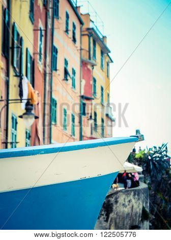 Travel Detail Of A Boat Against Historic Buildings In The Italian Cinque Terre Fishing Village Of Riomaggiore
