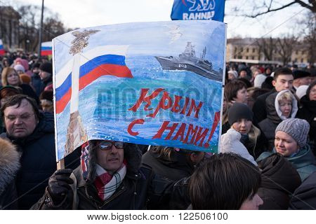Saint-Petersburg Russia - March 18 2016: the rally on the occasion of the second anniversary of the reunion of Crimea to Russia Participants of the meeting with the national flags of Russia