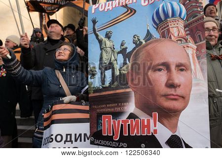 Saint-Petersburg, Russia - March 18, 2016: the rally on the occasion of the second anniversary of the reunion of Crimea to Russia, Participants of the rally with banners and posters President Putin.
