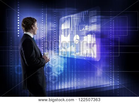 Back view of thoughtful businessman looking at virtual panel