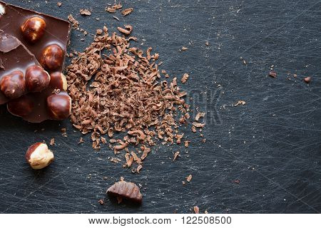 chocolate with nuts grated on a grater. close-up. Top view