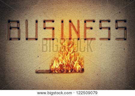 Burning match setting fire to its neighbors in arranged in shape of business word. Ignited match stick as a symbol for business risks and dangers.