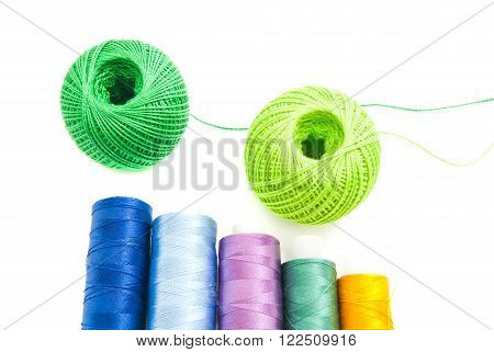 Spools Of Threads And Two Balls Of Yarn