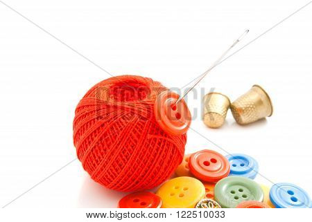 Plastic Buttons, Needle, Thimbles And Thread