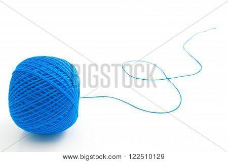Spool Of Blue Thread On White