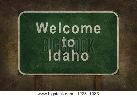 Welcome to Idaho road sign illustration with distressed ominous background