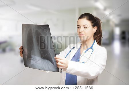 Caucasian young female doctor looking at a radiography