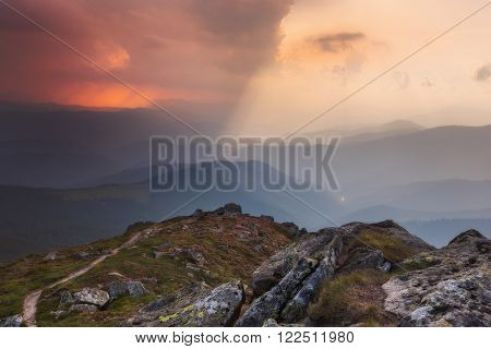 Carpathian Mountains. Mount Pop Ivan. The sky is divided light and darkness
