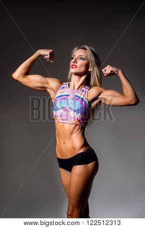 Female Fitness Bodybuilder, on a dark background