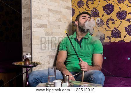 Man Smoking Shisha In The Arabic Cafe