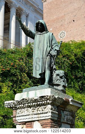 Bronze statue of Cola di Rienzo a very powerful politician in the medieval Rome who tried to unify Italy in the 14th century. The statue was cast in the 1887 and put on a ancient roman pedestal.