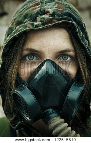 Post apocalypse. Female survivor in gas mask