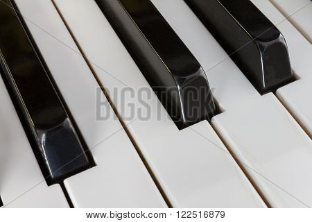 Extreme close-up of Piano keys from a diagonal perspective and shot with a shallow depth of field