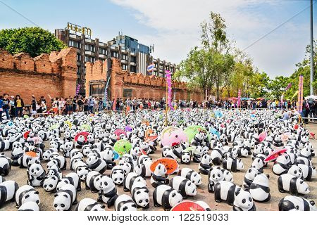 Chiang Mai, Thailand - March 19, 2016 : 1600 Pandas World Tour in Thailand at Tha Phae Gate in Chiang Mai. Made from recycled materials, Campaign by WWF for promoting animal preservation in Thailand.