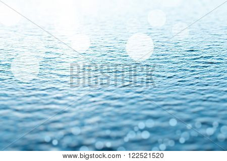 Sea water with sunbeams as background