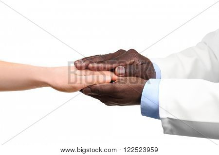 Handshake between doctor and patient isolated on white