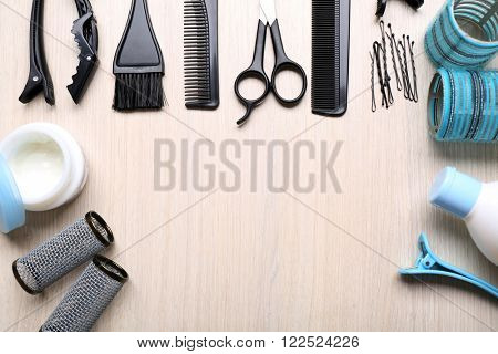Barber set with tools and cosmetic on light wooden table