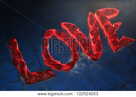 Red quilling word love on a glass over blue wooden background