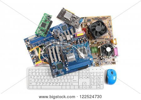 Computer motherboards with fans, keyboard and mouse, isolated on white