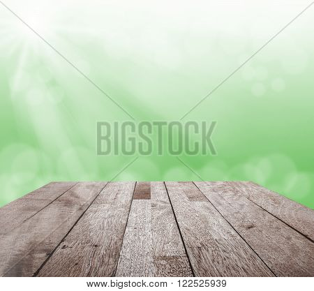 Wood floor top on green blurred bokeh light and sun ray Can be used for display or montage your products