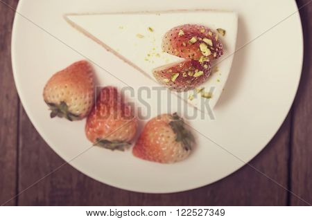 Close Up Of Strawberry Cream Cake On White On The Wood Background, Vintage Toning