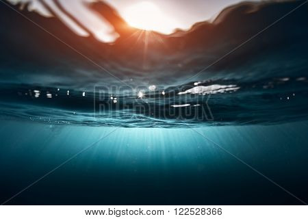 Underwater shot of the sea surface with waves in sunny day