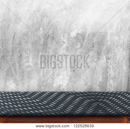 Black zig zag Fabric cover on table Black Marble table with Concrete wall ,empty interior for display your product,Business presentation