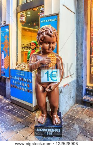 Brussels Belgian - January 17th 2015: Chocolate version of of the famous Manneken Pis statue in Brussels holding the famous Belgian waffle in front of a waffle shop