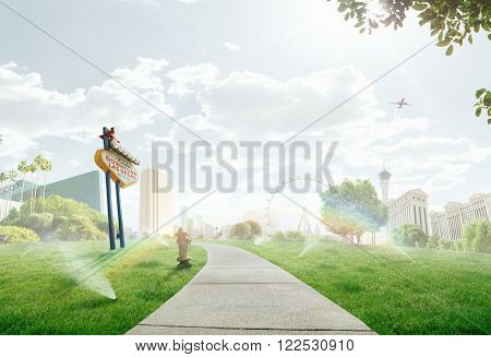 summer path through the lawn with  panorama view  of  Las Vegas on the back