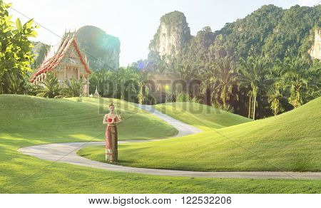 view of nice woman in thai national dress  in summer environment