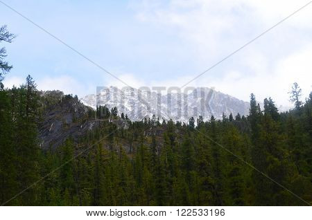 Picturesque snowy peak in the mountains of Siberia