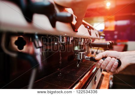 Professional Barman At Coffee Machine With Vapor Making Espresso In A Cafe