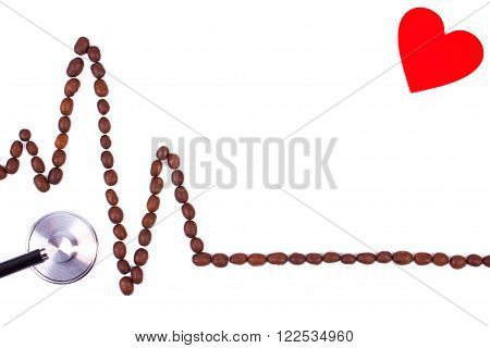 Electrocardiogram line of roasted coffee grains and medical stethoscope on white background copy space for text ecg heart rhythm medicine and healthcare concept