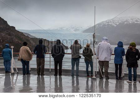 Amilia Glacier South Patagonia Chile - December 8 2012: Passengers on board the cruise ship Veendam viewing beautiful glacier. Taken at the Sarmiento Channel Chile on a overcast rainy day. Amalia Glacier also known as Skua Glacier is a tidewater glacier