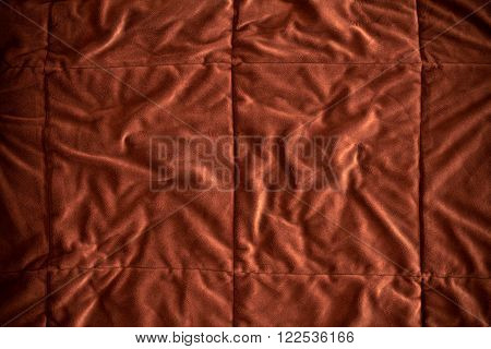 the close up on Crumpled golden brown fur fabric