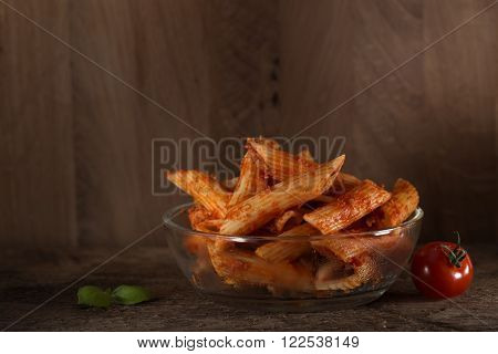 Italian cuisine penne Rigatoni Bolognese sauce noodles pasta meal in a glass bowl