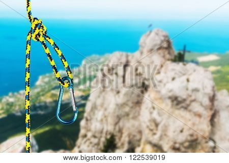 rock climbing rope with hooks on a background of mountains. focus on the rope