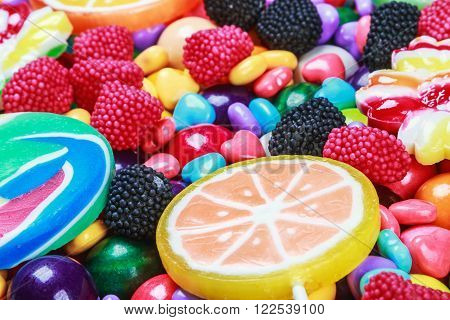 multicolored lollipops candy and chewing gum background. focus at the bottom of the frame