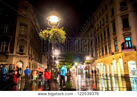 BELGRADE, SERBIA - SEPTEMBER 25: Rainy inght at Knez Mihailova Street on September 25, 2015 in Belgrade, Serbia. Street is the main shopping mile of Belgrade.