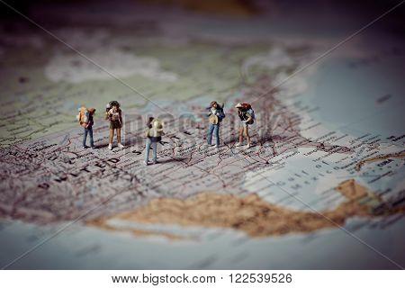 Miniature tourists in US. Color tone tuned. Macro photo