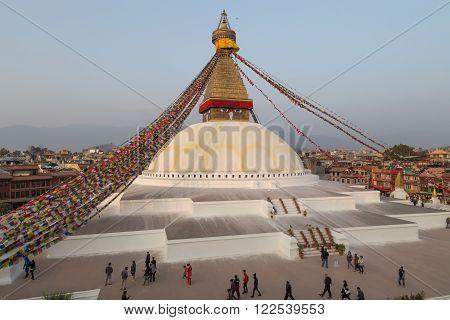 Kathmandu, Nepal - December 03, 2014: Pilgrims visiting the Buddhist Boudhanath Stupa.
