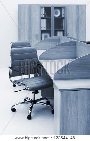 desks and bookcase on a white wall