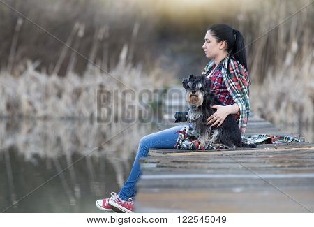 Girl With Dog On The Dock