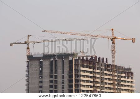 Crane under construction building with sky background ** Note: Soft Focus at 100%, best at smaller sizes