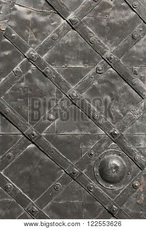 Detail of medieval hammered and riveted gate as texture